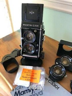 Mamiya C330f camera with 80mm, 55mm, 135mm lens, Prism finder & Instruction Book